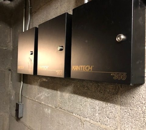 3 security panels 3 across on concrete wall